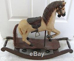 Antique Vtg rocking horse Carved Wood Leather Saddle Cast Iron Wheels Glass Eyes